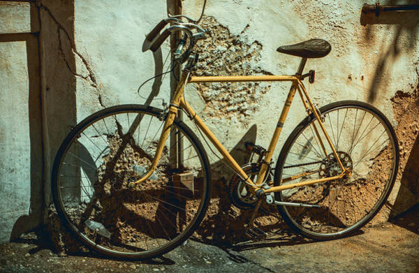 Old Bike Against And Old Wall Poster
