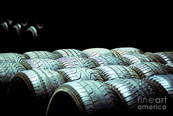 Old Tires And Racing Wheels Stacked In The Sun Poster