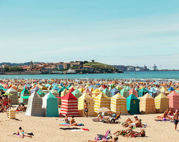 People Relaxing On Gijón Beach Poster