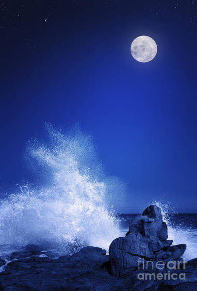 Rising Moon Over Rocky Coastline At Poster