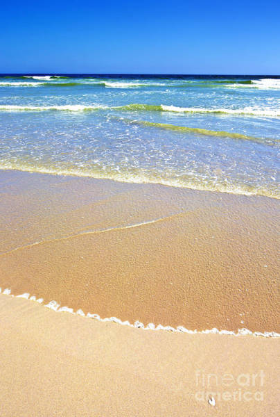 Sandy Beach And Ocean On A Sunny Day Poster