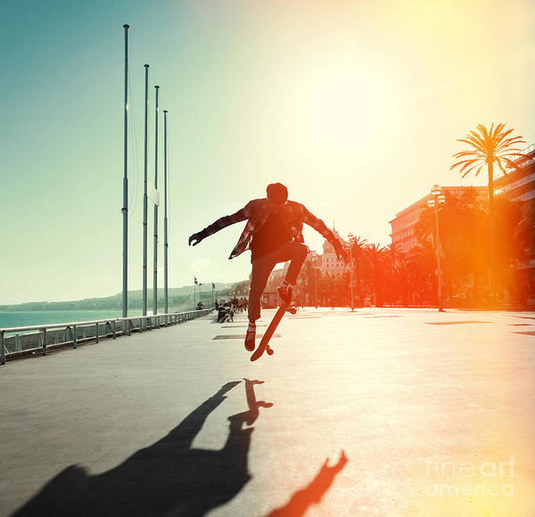 Silhouette Of Skateboarder Jumping In Poster