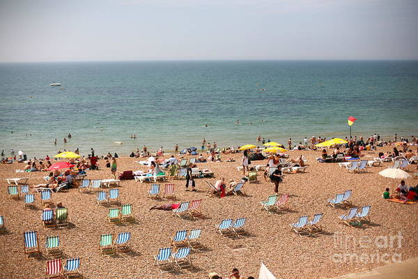 Summertime Beach Near Ocean Crowded Poster