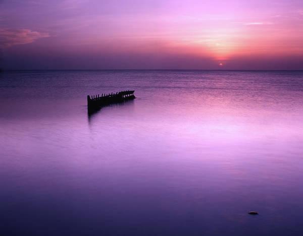 Sun Sets On A Sunken Boat Poster