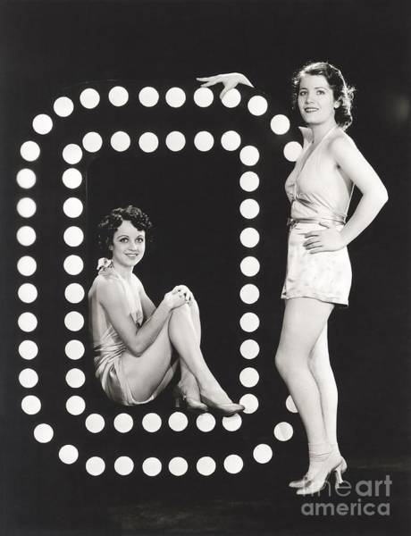 Two Models Posing By Large Letter O Poster
