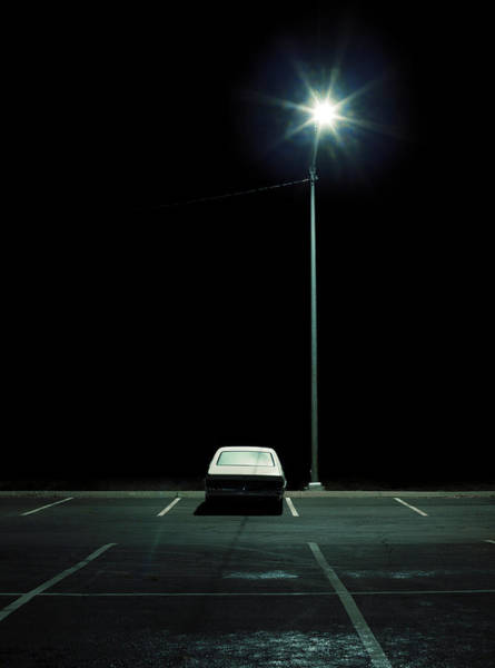 Vehicle In Parking Lot At Night Poster