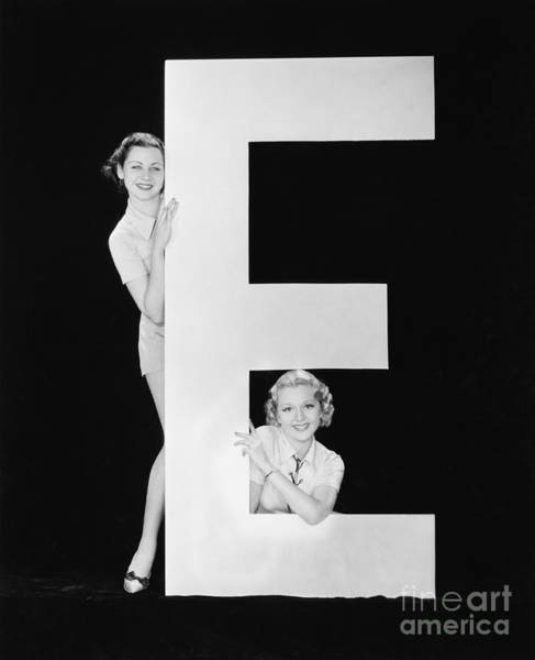Women Posing With Huge Letter E Poster