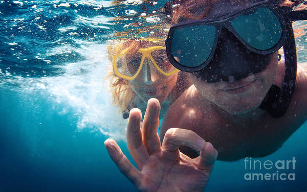 Young Couple Having Fun Underwater And Poster