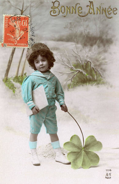 Four Leaf Clover Photograph -  A Boy Stands In The Snow  Holding by Mary Evans Picture Library