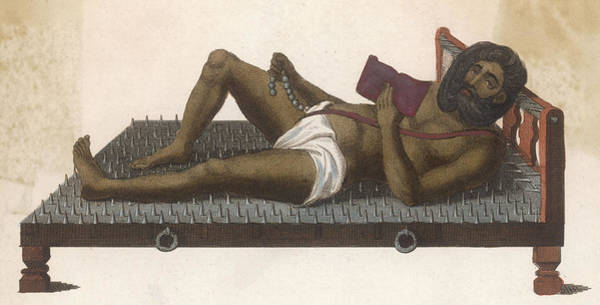 Wall Art - Photograph -  An Ascetic Lies On His Bed Of  Nails by Mary Evans Picture Library