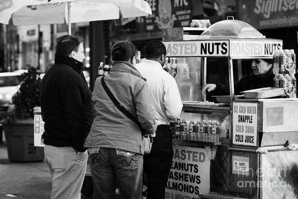 Service Dog Photograph -  Vendor Selling Roasted Nuts And Soft Drinks To Queue Of  People New York City by Joe Fox