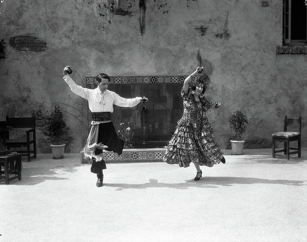 Folk Dances Photograph - 1920s Smiling Couple Dressed In Spanish by Vintage Images