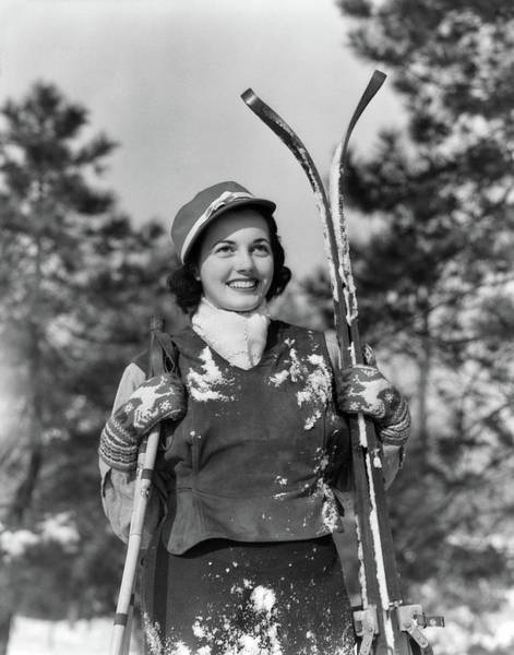 Wall Art - Photograph - 1930s Smiling Woman Holding Skis by Vintage Images