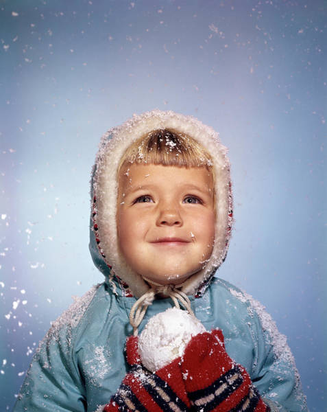 Knit Hat Photograph - 1960s Little Girl Holding Snow Ball by Vintage Images
