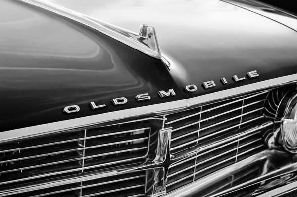 Oldsmobile Wall Art - Photograph - 1962 Oldsmobile Starfire Hardtop Hood Ornament - Emblem by Jill Reger
