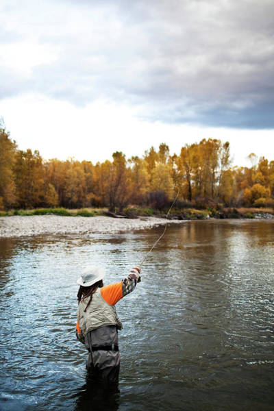 Wall Art - Photograph - A Athletic Man Fly Fishing Stands by Patrick Orton