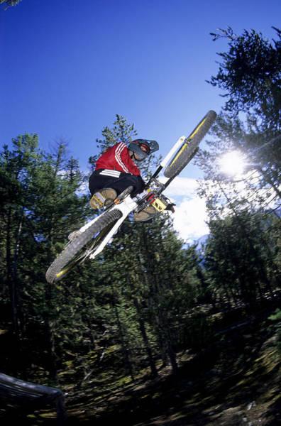 Pemberton Photograph - A Biker Rides His Mountain Bike by Scott Markewitz