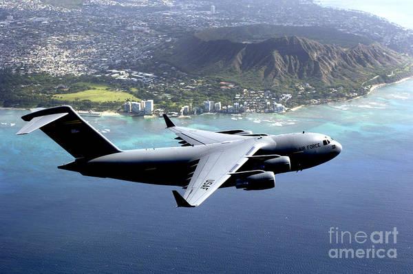 C-17 Photograph - A C-17 Globemaster IIi Flies Over Hawaii by Celestial Images