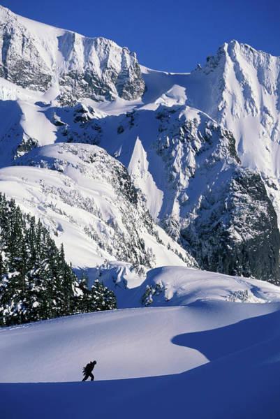 A Female Snowboarder Hiking Art Print