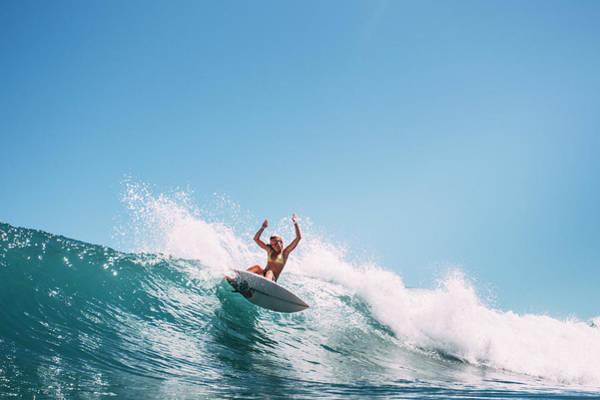La Gomera Wall Art - Photograph - A Girl Surfs A Wave In A Bikini by Sergio Villalba