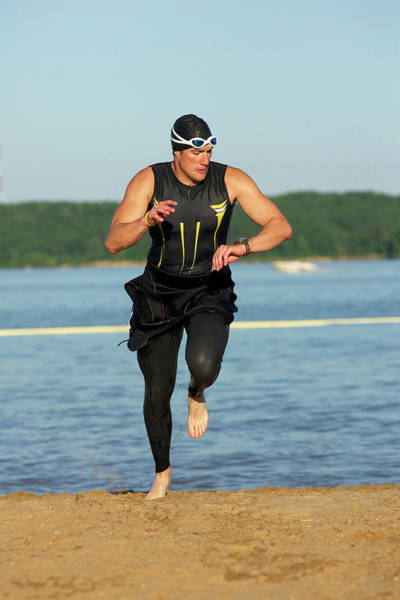 Wetsuit Wall Art - Photograph - A Male Athelete Running by Gary Rohman