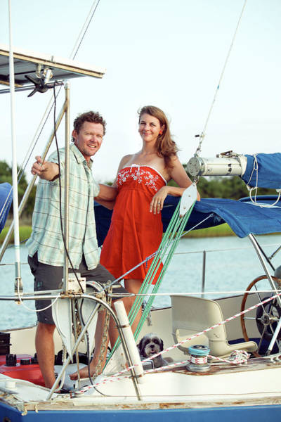Wrightsville Beach Wall Art - Photograph - A Man And A Woman On Sailboat by Eyeconic Images