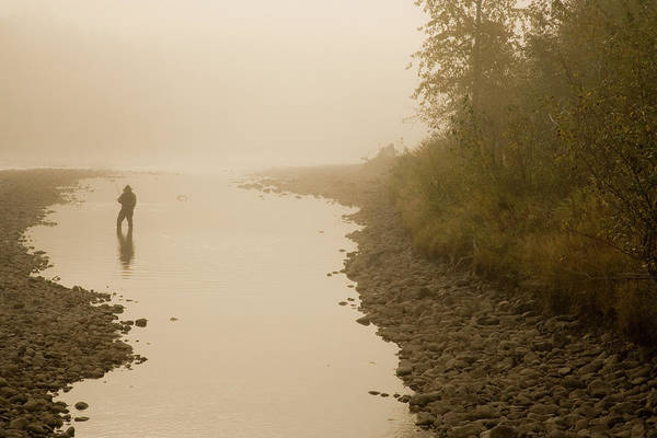 Fly Fishermen Photograph - A Man Fly-fishing On Elk River, Bc by Henry Georgi
