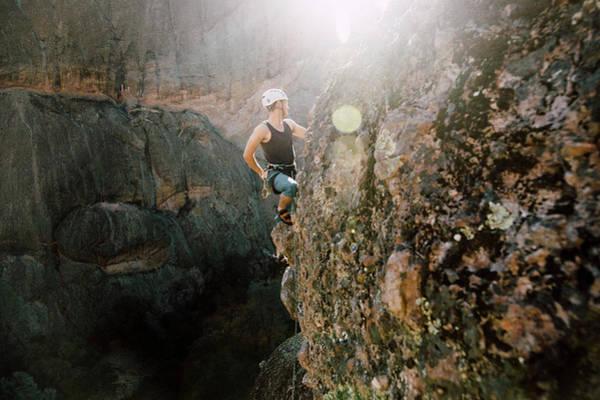 Wall Art - Photograph - A Man Rock Climbing In Pinnacles by Ryan Tuttle