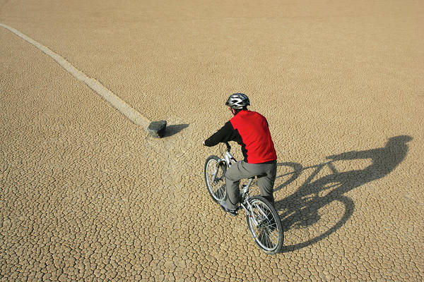 Wall Art - Photograph - A Mountain Biker In Death Valley by Olivier Renck