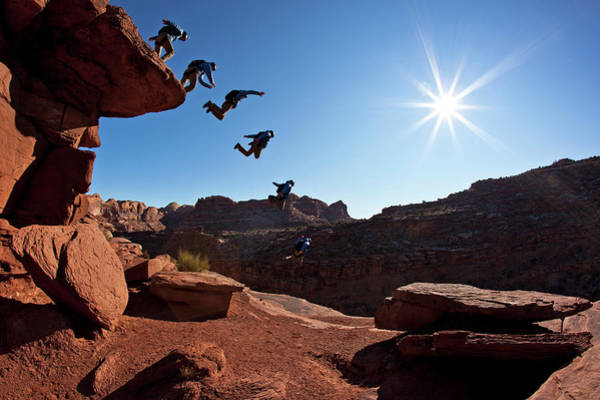 Base Jumping Photograph - A Person Basejumping Off A Cliff by Whit Richardson