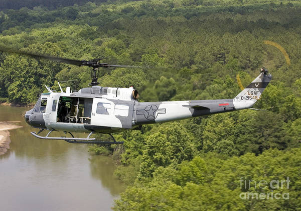 Utility Helicopter Photograph - A U.s. Air Force Uh-1h Huey In An by Erik Roelofs
