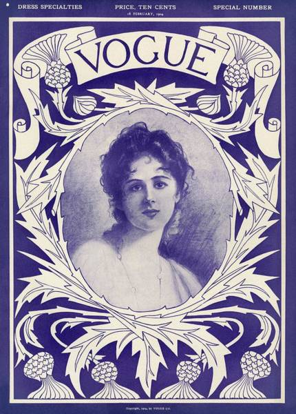 Blue Flower Photograph - A Vintage Vogue Magazine Cover Of A Woman by Artist Unknown