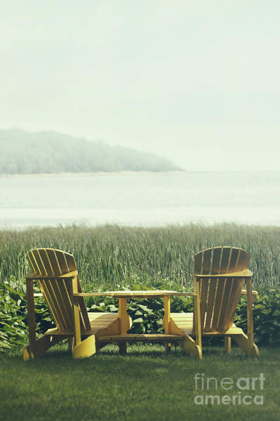 Photograph - Adirondack Chairs On The Grass By The Lake by Sandra Cunningham