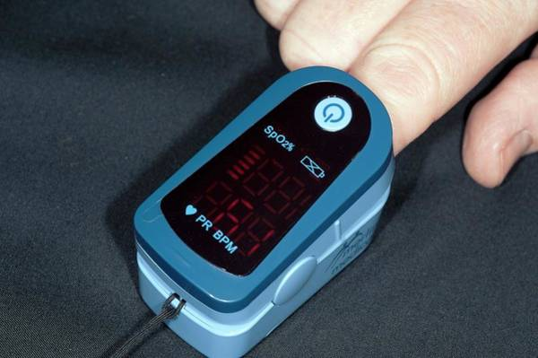 Pulse Photograph - Adult Pulse Oximeter by Dr P. Marazzi/science Photo Library