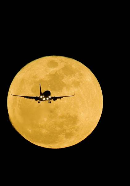Wall Art - Photograph - Aeroplane Silhouetted Against A Full Moon by David Nunuk