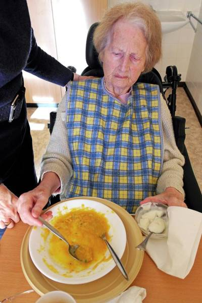 German Food Photograph - Alzheimer's Patient Being Fed by Tony Craddock