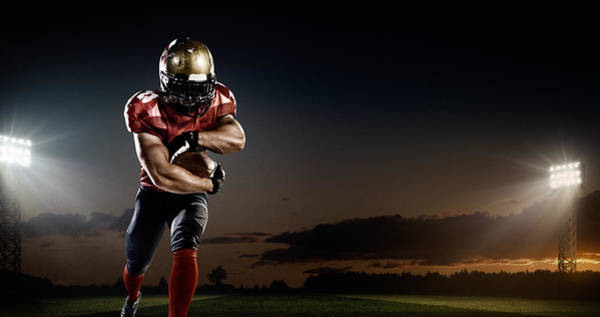 Football Helmet Photograph - American Football In Action by Dmytro Aksonov