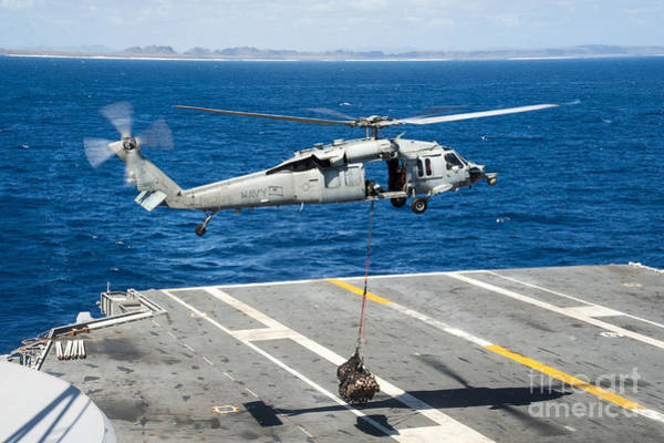 Uss George Washington Wall Art - Photograph - An Mh-60s Sea Hawk Delivers Supplies by Stocktrek Images