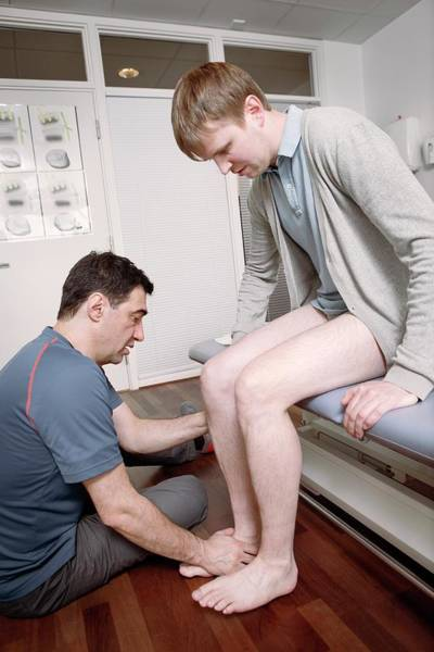 Therapy Photograph - Ankle Physiotherapy by Thomas Fredberg