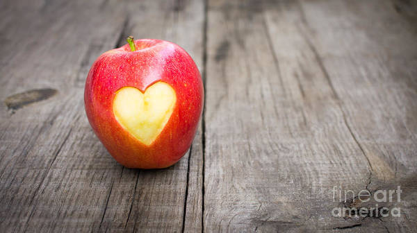 Wall Art - Photograph - Apple With Engraved Heart by Aged Pixel