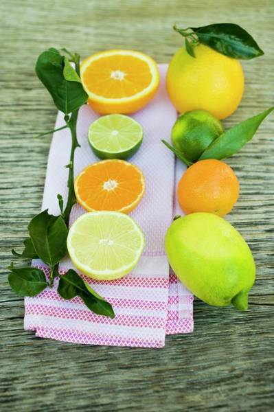 Wall Art - Photograph - Assorted Citrus Fruit, Whole And Halved by Foodcollection