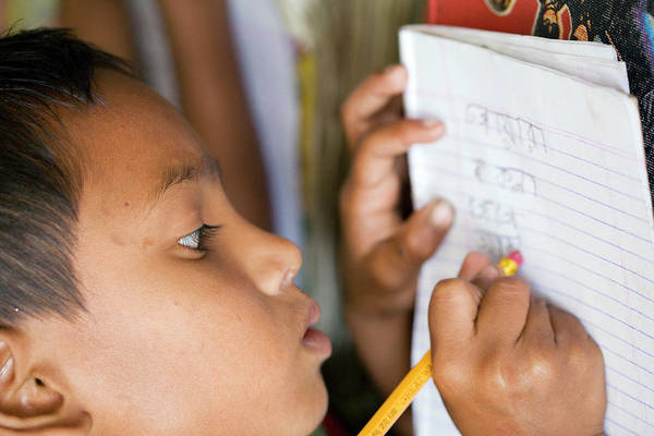 Written Language Photograph - Bangladeshi School Pupil by Adam Hart-davis/science Photo Library
