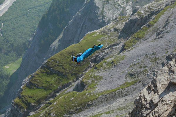 Base Jumping Photograph - Base Jumper Flying In Wingsuit by Woods Wheatcroft