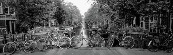 Anchor Photograph - Bicycles On Bridge Over Canal by Panoramic Images