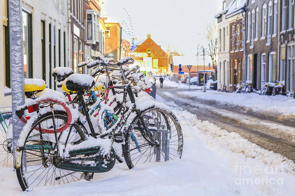 Bicycle Rack Photograph - Bikes In The Snow by Patricia Hofmeester
