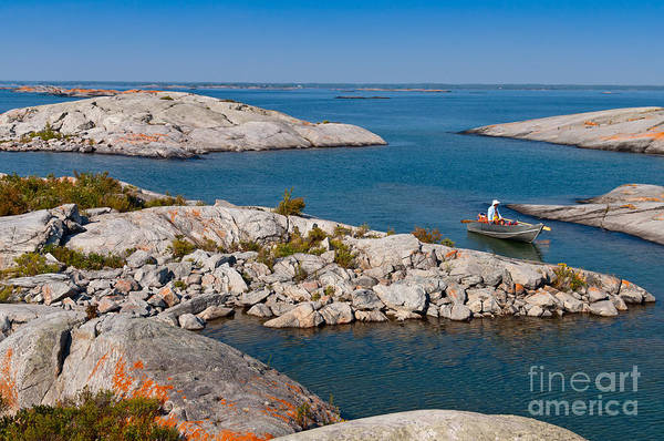 Photograph - Boat Between Rocky Islands by Les Palenik