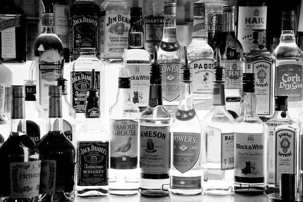 Irish Whiskey Photograph - Bottles Of Liquor, De Luans Bar by Panoramic Images
