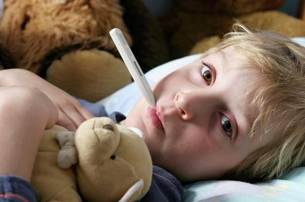 Fever Photograph - Boy With A Fever by Claire Deprez/reporters/science Photo Library