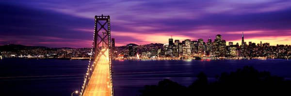 Wall Art - Photograph - Bridge Lit Up At Dusk, Bay Bridge, San by Panoramic Images