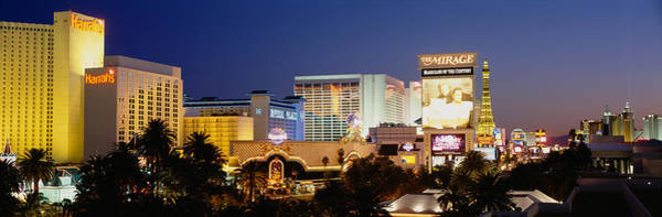 Harrahs Photograph - Buildings Lit Up At Dusk, Las Vegas by Panoramic Images